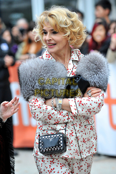 Fanny Ardent<br /> &quot;Bright Days Ahead&quot; Premiere 2013 Toronto International Film Festival held at Roy Thomson Hall, Toronto, Ontario, Canada, <br /> 13th September 2013.<br /> TIFF half length red white print jacket suit grey gray fur wrap cape black bag bow arms crossed folded <br /> CAP/ADM/BPC<br /> &copy;Brent Perniac/AdMedia/Capital Pictures