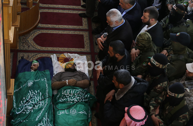 Palestinians pray in front of the bodies of Hamas militant Ahmed al-Zahar and Fuad Abu Atewi whom killed when a tunnel collapse on Tuesday, during his funeral in the village of Al-Moghraga near central Gaza Strip, February 3, 2016. The collapse of a tunnel in the Gaza Strip has killed two militants from Hamas's armed wing, officials said Wednesday, as concern grows in Israel over the rebuilding of tunnels that can be used for attacks. Photo by Mohammed Asad