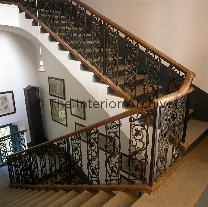 A traditional wrought-iron staircase and stone steps.
