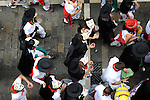 People celebrate the San Fermin Festival on July 12, 2014, in Pamplona, Basque Country. Every year, tens of thousands of people pack Pamplona's streets for a drunken kick-off to one os worls's best-known fiesta: the nine-day San Fermin bull-running festival. (Ander Gillenea / Bostok Photo)