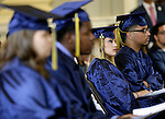Waterbury, CT- 13 June 2016-061316CM05-Enlightenment School graduates listen in during commencement exercises at City Hall in Waterbury on Monday.      Christopher Massa Republican-American