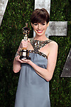 """February 24, 2013, West Hollywood,Ca. --- Actress Anne Hathaway  arrives with her Oscar for  Actress in a Supporting Role -  """"Les Miserables"""" at the 2013 Vanity Fair Academy Awards Oscars® Party at Sunset Tower Hotel in West Hollywood. --- Chris Farina"""