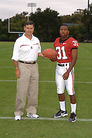 7 August 2006: Stanford Cardinal head coach Walt Harris and Tyrone McGraw during Stanford Football's Team Photo Day at Stanford Football's Practice Field in Stanford, CA.