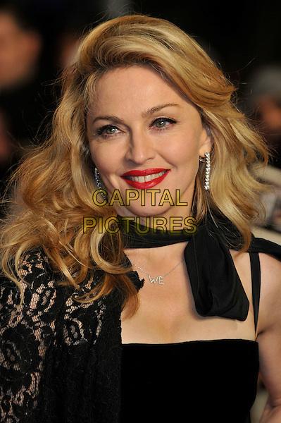 Madonna.W.E. Uk film premiere at Odeon cinema, Kensington, London, England..11th January 2011.headshot portrait black lace bow red lipstick smiling .CAP/PL.©Phil Loftus/Capital Pictures.