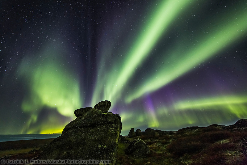 Aurora borealis displays over the weathered granite tors on the ridges in the Bering Land Bridge National Preserve, Seward Peninsula, Alaska.