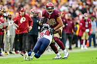 Landover, MD - November 18, 2018: Washington Redskins tight end Jordan Reed (86) picks up a first down during first half action of game between the Houston Texans and the Washington Redskins at FedEx Field in Landover, MD. (Photo by Phillip Peters/Media Images International)