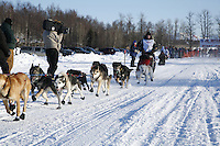 Saturday, February 24th, Knik, Alaska.  Jr. Iditarod musher Cain Carter leaves start line on Knik Lake