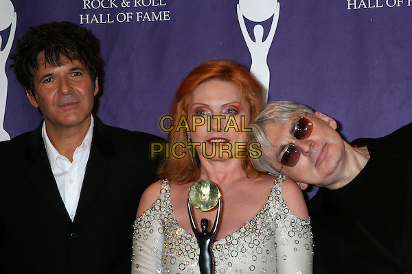 CLEM BURKE, DEBBIE HARRY & CHRIS STEIN- BLONDIE.21st Annual Rock and Roll Hall of Fame Induction Ceremony at the Waldorf Astoria in New York City, New York, USA..March 13th, 2006.Ref: IW.Deborah headshot portrait sunglasses shades head on shoulder leaning.www.capitalpictures.com.sales@capitalpictures.com.©Capital Pictures
