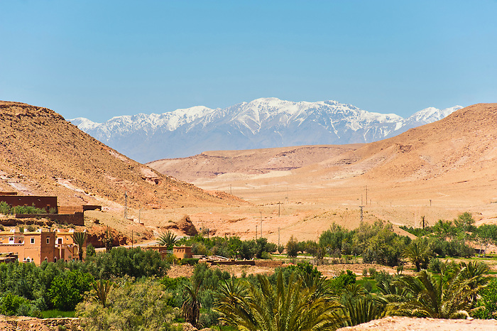 Photo of the view of snow capped High Atlas Mountains from Kasbah Ait Ben Haddou, UNESCO World Heritage Site, near Ouarzazate, Morocco, North Africa, Africa. This photo shows Kasbah Ait Ben Haddou, an impressive fortified city ('ksar' or 'ksour' meaning castle in Moroccan), which is a UNESCO World Heritage Site and has been used in numerous films including The Mummy, Gladiator and The Jewel of the Nile.