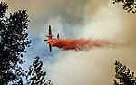 September 12, 2004 Buck Meadows --Tuolumne Fire –- On Cherry Oil Road, air tanker drops retardant on fire line.  The Tuolumne Fire was a small very fast-moving fire that started around noon on September 12, 2004 near Lumsden Bridge at the bottom of the Tuolumne River.  The fire moved rapidly up the 80-plus-degree slope catching Cal Fire Helitack firefighters, tragically killing firefighter Eva Marie Schicke and injuring five others.