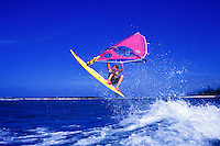 Eleven year old Blake McElheny takes a flying leap into the air with his sailboard at Sunset Beach on the north shore of Oahu