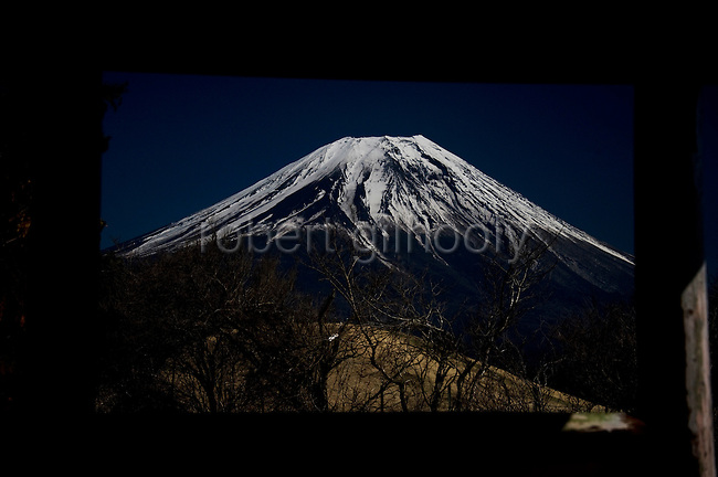Mt Fuji is framed in the timber opening of a shelter on a walk that takes trekkers through parts of the Asagiri Plateau in Shizuoka Prefecture Japan on 22 March 2013.  Photographer: Robert Gilhooly