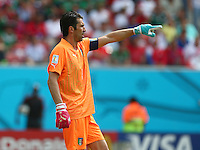Italy goalkeeper Gianluigi Buffon wearing odd coloured Puma goalkeeping gloves