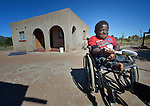 Peter Makura studies outside his home in the village of Berejena, near Masvingo, Zimbabwe. Makura uses a wheelchair provided by the Jairos Jiri Association with support from CBM-US.