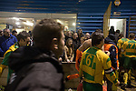 Away team players making their way to the dressing rooms after the Boxing Day derby match between Runcorn Town and visitors Runcorn Linnets at the Pavilions, Runcorn, in a top-of the table North West Counties League premier division match. Runcorn Linnets won 1-0 and overtook their neighbours at the top of the league in a game watched by 803 spectators. Runcorn Linnets were a successor club to Runcorn FC, one of England foremost non-League clubs of the 1970s and 1980s.