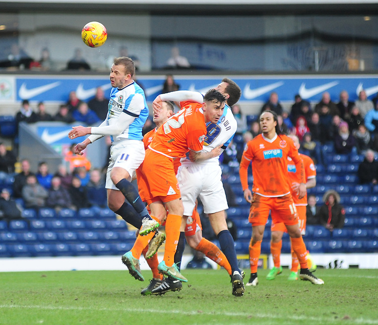 Blackburn Rovers' Jordan Rhodes gets above Blackpool's Grant Hall for a header<br /> <br /> Photographer Andrew Vaughan/CameraSport<br /> <br /> Football - The Football League Sky Bet Championship - Blackburn Rovers v Blackpool - Saturday 21st February 2015 - Ewood Park - Blackburn<br /> <br /> &copy; CameraSport - 43 Linden Ave. Countesthorpe. Leicester. England. LE8 5PG - Tel: +44 (0) 116 277 4147 - admin@camerasport.com - www.camerasport.com