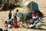 MEXICAN FAMILY CAMPS ON BEACH DURING SEMANA SANTA