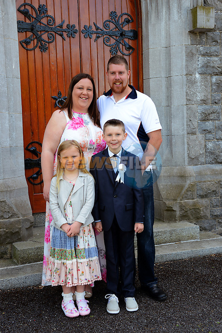 23/05/2015 – Termonfeckin Communion – Tadgh Johnson with his parents Emma and Mark and little sister Caoimhe.