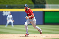 Mike Papi (12) of the Columbus Clippers hustles towards third base against the Durham Bulls at Durham Bulls Athletic Park on June 1, 2019 in Durham, North Carolina. The Bulls defeated the Clippers 11-5 in game one of a doubleheader. (Brian Westerholt/Four Seam Images)