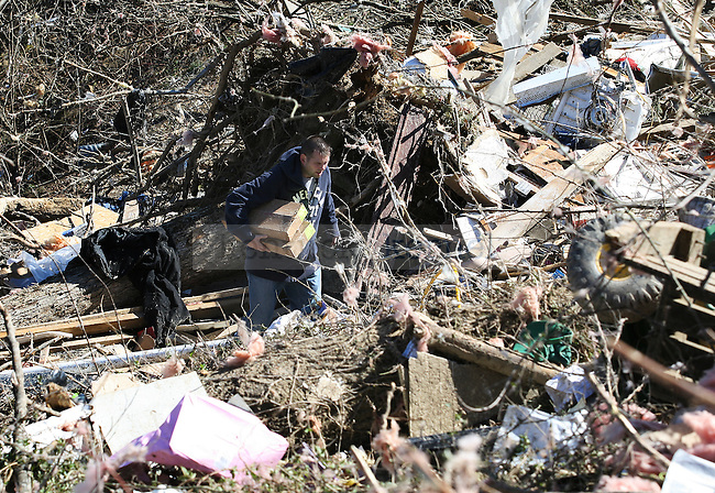 Residents of East Bernstadt in Laurel County, Ky. returned to pick up belongings on March 3, following the March 2, 2012 tornado in which five people in the county were killed. Photo by Latara Appleby | Staff ..