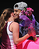 Kerri Goldfuss and Christian Azcona of Clarke High School embrace during the Cougar Invitational held at Bellmore JFK High School on Saturday, Apr. 16, 2016. Moments after Goldfuss competed in the girls 3,000 meter run, Azcona surprised her with flowers and a cardboard sign which he used to ask her to Clarke's prom.