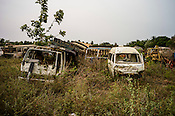 Abandoned vehicles sit in a yard on the highway in Kilinochchi, in northern Sri Lanka. Photo: Sanjit Das/Panos
