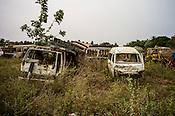 Abandoned vehicles sit in a yard on the highway in Kilinochchi, in northern Sri Lanka. Photo: Sanjit Das/Panos