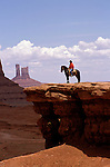AZ, Monument Valley, Bruce, Native American Navajo Indian on horseback, bluff, model released .Photo Copyright: Lee Foster, lee@fostertravel.com, www.fostertravel.com, (510) 549-2202.Image: azmonu201