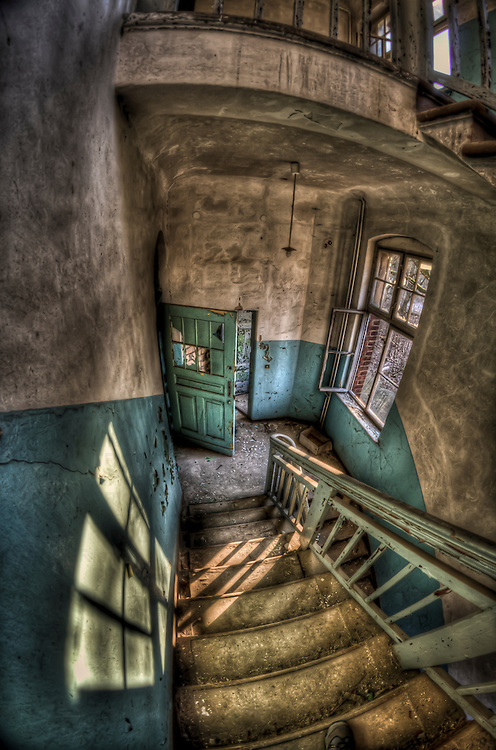 Abandoned lunatic asylum north of Berlin, Germany. Looking down stairwell.