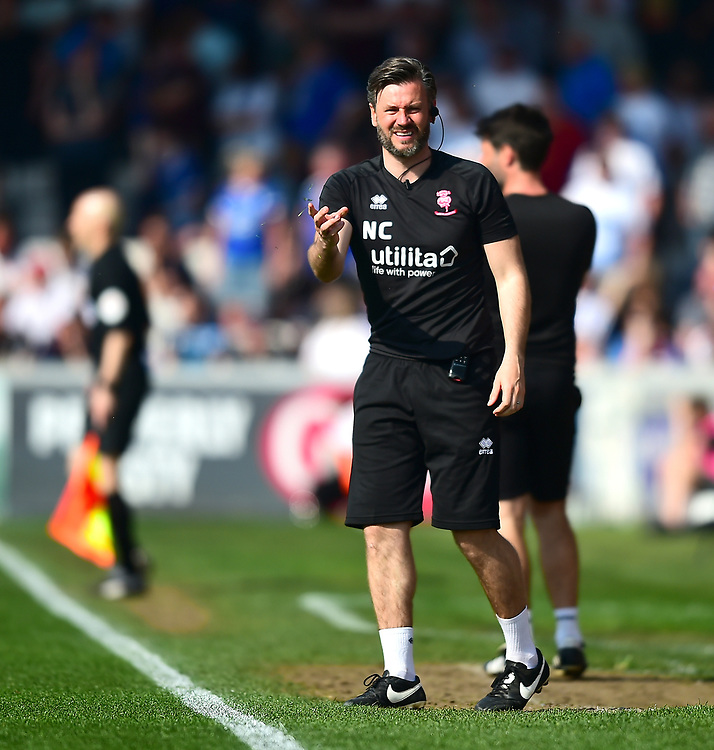 Lincoln City's assistant manager Nicky Cowley shouts instructions to his team from the technical area<br /> <br /> Photographer Andrew Vaughan/CameraSport<br /> <br /> The EFL Sky Bet League Two - Lincoln City v Tranmere Rovers - Monday 22nd April 2019 - Sincil Bank - Lincoln<br /> <br /> World Copyright © 2019 CameraSport. All rights reserved. 43 Linden Ave. Countesthorpe. Leicester. England. LE8 5PG - Tel: +44 (0) 116 277 4147 - admin@camerasport.com - www.camerasport.com