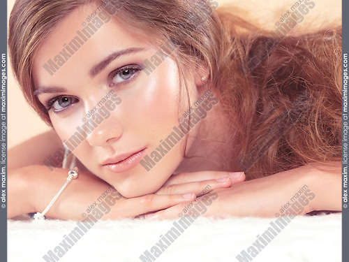 Soft and light natural beauty expressive closeup portrait of a young beautiful woman
