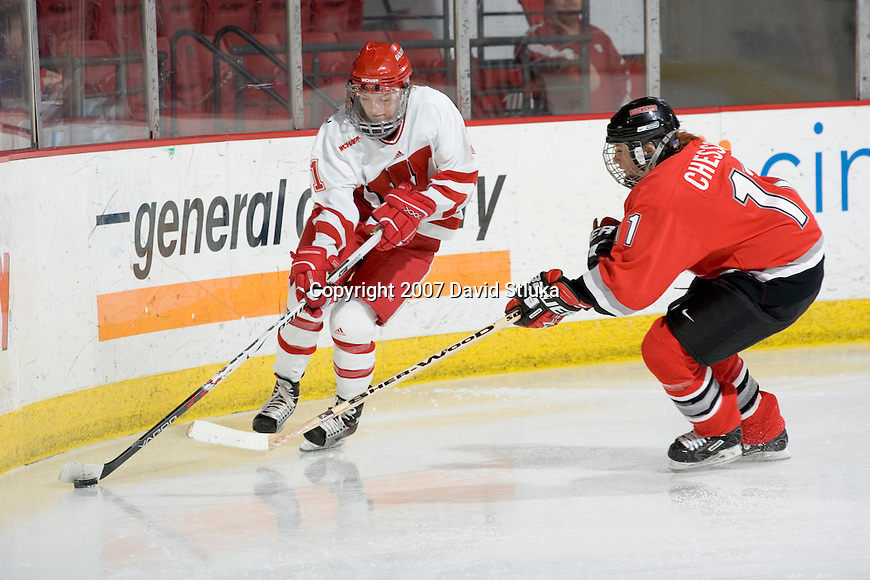 MADISON, WI - FEBRUARY 11: Kyla Sanders #11 of the Wisconsin Badgers women's hockey team handles the puck against the Ohio State Buckeyes at the Kohl Center on February 11, 2007 in Madison, Wisconsin. The Badgers beat the Buckeyes 3-2. (Photo by David Stluka)