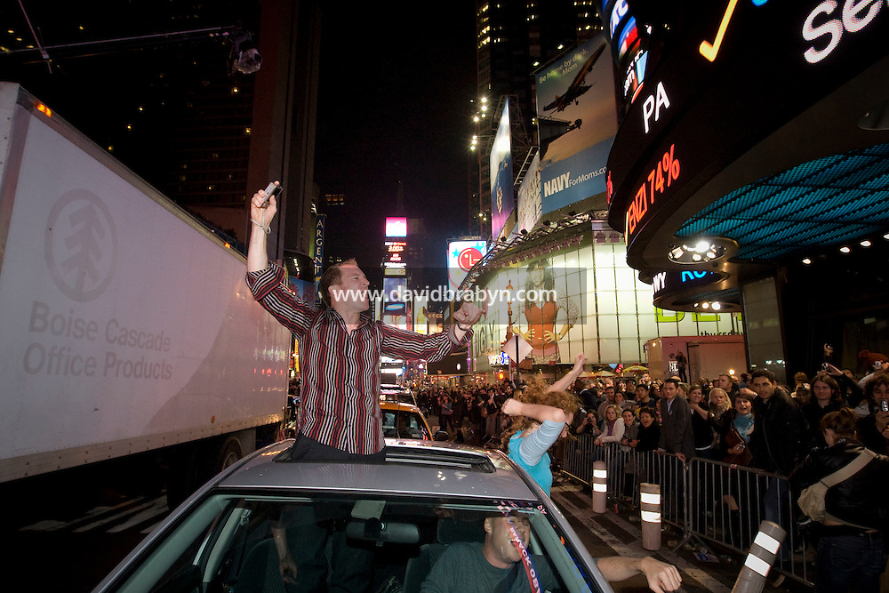 People celebrate on Times Square in New York, NY, United States, after watching television coverage of Barack Obama's victory in the 2008 US presidential election on a giant screen, 4 November 2008.