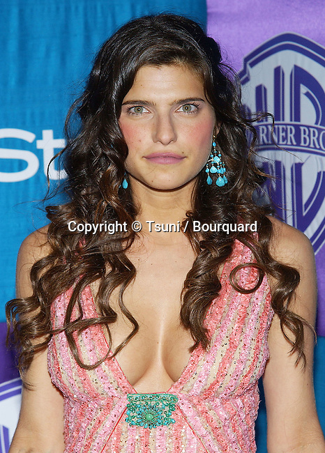 Lake Bell arriving In Style Warner Party at the Golden Globes Awards  Los Angeles. January 16, 2005.