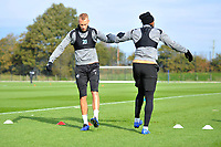 Mike van der Hoorn (left) and Leroy Fer (right) of Swansea City stretch during the Swansea City Training at The Fairwood Training Ground, in Swansea, Wales, UK. Wednesday 02 November 2018