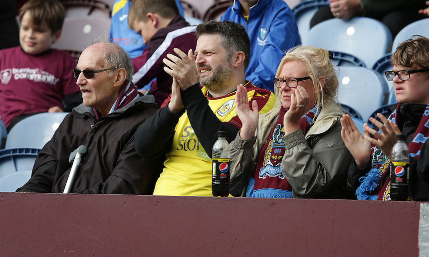 Burnley fans watch their team secure a 3-1 victory<br /> <br /> Photographer Stephen White/CameraSport<br /> <br /> Football - The Football League Sky Bet Championship - Burnley v Sheffield Wednesday - Saturday 12th September 2015 -  Turf Moor - Burnley<br /> <br /> &copy; CameraSport - 43 Linden Ave. Countesthorpe. Leicester. England. LE8 5PG - Tel: +44 (0) 116 277 4147 - admin@camerasport.com - www.camerasport.com