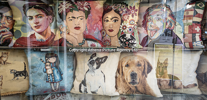 Pictured: A collection of cushions in a shop window.<br /> Re: Street photography, Athens, Greece. Thursday 27 February 2020