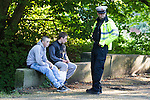 © Joel Goodman - 07973 332324 . 16 August 2013 . Manchester , UK . Friends of injured 15 year old (one of whom was also injured) watch his treatment alongside Inspector Bailey-Smith after the victim (not pictured) suffered a severe leg break in Wythenshawe Park following a motorbike crash . Drive along with Inspector Matt Bailey-Smith ( 16366 ) of Greater Manchester Police 's Serious Collision Unit . Photo credit : Joel Goodman