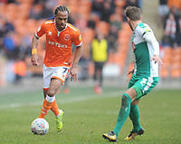 Blackpool's Nathan Delfouneso under pressure from Plymouth Argyle's Gary Sawyer<br /> <br /> Photographer Kevin Barnes/CameraSport<br /> <br /> The EFL Sky Bet League One - Blackpool v Plymouth Argyle - Saturday 30th March 2019 - Bloomfield Road - Blackpool<br /> <br /> World Copyright © 2019 CameraSport. All rights reserved. 43 Linden Ave. Countesthorpe. Leicester. England. LE8 5PG - Tel: +44 (0) 116 277 4147 - admin@camerasport.com - www.camerasport.com