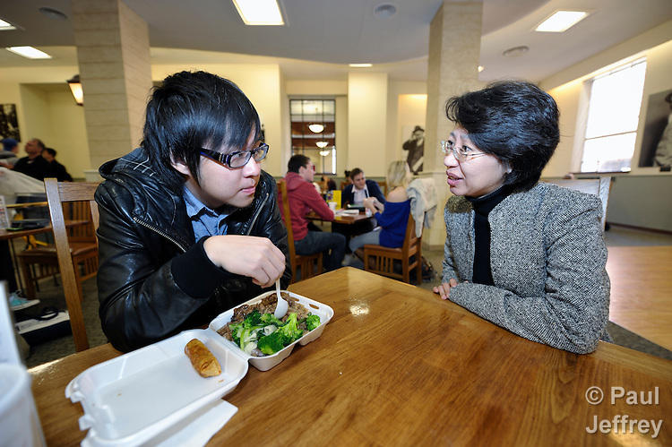 The Rev. Fuxia Wang (right) is a United Methodist missionary, serving as a church and community worker on the staff of the Wesley Center at the University of Oklahoma in Norman, where she works with international students. Here she talks with Emmanuel Lo, a Chinese student.