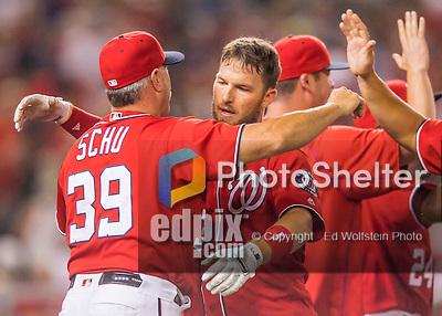 23 July 2016: Washington Nationals shortstop Stephen Drew is congratulated by hitting coach Rick Schu after Drew hits a pinch-hit walk-off triple, scoring Anthony Rendon in the bottom of the 9th inning, as the Nationals take the second game of their 3-game series 3-2 against the San Diego Padres at Nationals Park in Washington, DC. The win ties their series at one game apiece. Mandatory Credit: Ed Wolfstein Photo *** RAW (NEF) Image File Available ***