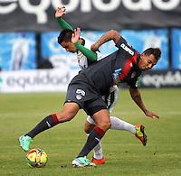 BOGOTA-COLOMBIA-03 -11-2013 : Stalin Motta  (Izq) de La Equidad Seguros disputa el balon con  Edwin Cardona  ( Der)  delantero  del Atletico Junior durante partido por la fecha 17 de la Liga Postobon II-2013 ,jugado en el estadio Metroplitano de Techo de la ciudad de Bogota./ Stalin Motta (L) of the Equidad Seguros disputes the ball with Edwin Cardona  striker match Atletico Junior during the date 17 of the League Postobon II-2013, played at the Metropolitano  de Techo  Stadium  in Bogota city.Pohoito:VizzorImage / Felipe Caicedo / Staff