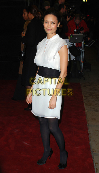 "THANDIE NEWTON.Attends the UK Film Premiere of ""The Pursuit of Happyness"", Curzon  Mayfair Cinema, London, England, 8th January 2007..full length white dress collar black waist band belr tights shoes.CAP/CAN.©Can Nguyen/Capital Pictures"