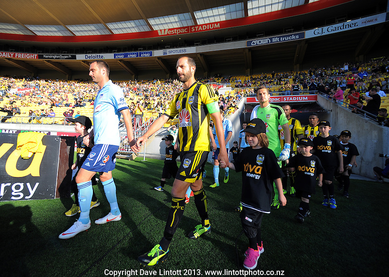 Phoenix captain Andrew Durante leads his team out during the A-League football match between Wellington Phoenix and Sydney FC at Westpac Stadium, Wellington, New Zealand on Sunday, 22 December 2013. Photo: Dave Lintott / lintottphoto.co.nz