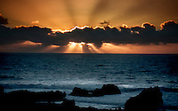 The sun sets over the Pacific Ocean near Big Sur, California