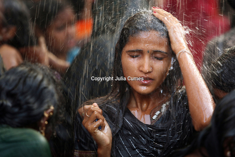 "A young woman bathes in a communal bathing area before worshipping at the Yellamma temple during the Yellamma Festival in Saundatti, India. As part of Yellamma custom, all worshippers must wash before worshipping and during the full moon festival, young girls from impoverished lower caste families are ""married"" to the goddess Yellamma to appease her. Once they are married to Yellamma, they are regarded as servants to the deity and must perform temple duties as well as satisfy the sexual needs of the priests and other men in the community. They may no longer marry a man and often end up being sold by unscrupulous priests to pimps who take them to work in the red-light districts of India's urban areas."