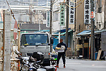 A wholesaler carries some boxes to his truck at Tokyo's Tsukiji Wholesale Fish Market on October 10, 2018, Tokyo, Japan. Tokyo's iconic fish market closed its doors for the last time on October 6 for a move to a newly created facility, ''The Toyosu Fish Market,'' which will start operating on October 16. The wholesale fish market in Tsukiji first opened in the mid-1930s and was one of the Japanese capital's most popular destinations for international tourists. (Photo by Rodrigo Reyes Marin/AFLO)