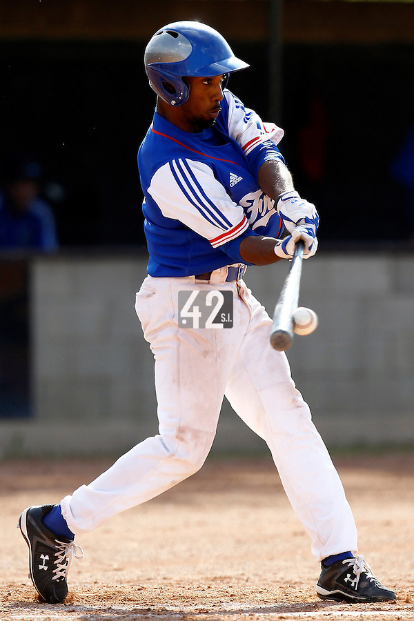 24 June 2011: Felix Brown of Team France makes contact during France 8-5 win over UCLA Alumni, at the 2011 Prague Baseball Week, in Prague, Czech Republic.