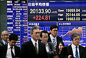 Pedestrians stand in front of the stock market indicator board on April 22, 2015, Tokyo, Japan. The Japan stock market broke 20,000 yen during the morning trading session of the Tokyo Stock Exchange. (Photo by Rodrigo Reyes Marin/AFLO)