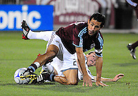 25 October 08: Rapids midfielder Pablo Mastroeni gets tangled up with Real Salt Lake midfielder Will Johnson (in white). Real Salt Lake tied the Colorado Rapids 1-1 at Dick's Sporting Goods Park in Commerce City, Colorado. The tie advanced Real Salt Lake to the playoffs.